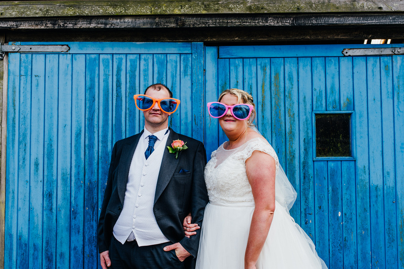 The bride and groom wearing glasses at a wedding at Soltan Manor