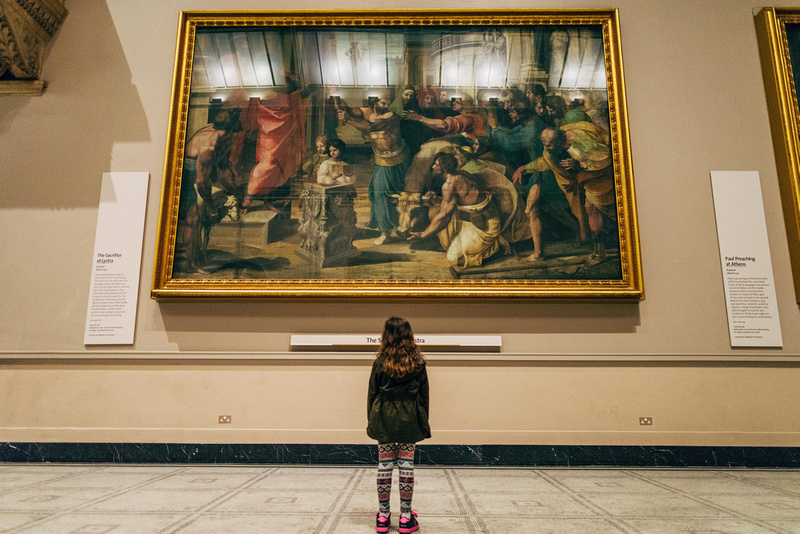 photography of a little girl looking at the art work  at Victoria and Albert Museum London