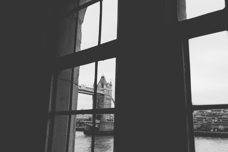 Tower bridge through a window at the tower of london