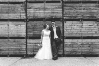 bride and groom at their farm wedding in kent posing for their kent wedding photography