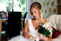 Bride waiting with her bouquet before her wedding at Reads restaurant in Faversham
