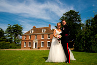 bride and groom standing outside reads restaurant posing for their kent wedding photography