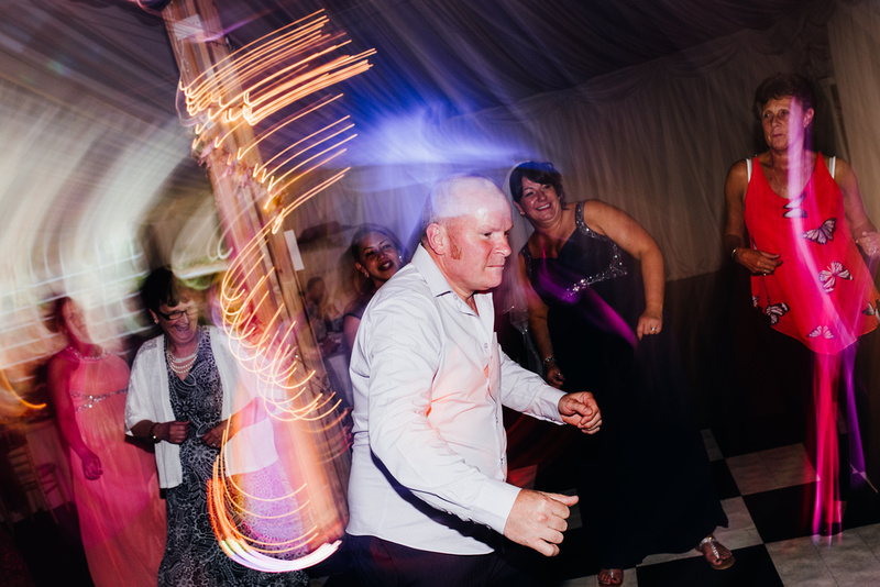 A guest dancing during the reception at Soltan Manor