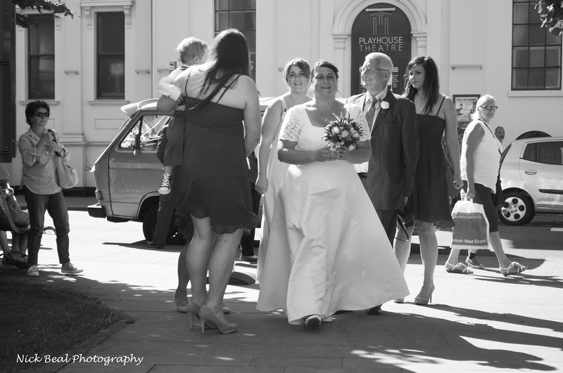 The bride with her dad arriving at the church for a wedding in whitstable