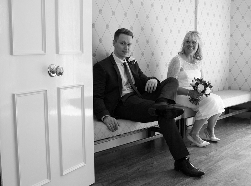 The bride and son waiting for her wedding in CanterburyKent wedding photography